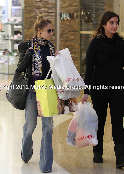 27 May 2012 Sydney, Australia..NON EXCLUSIVE..Nicole Richie and a friend take an afternoon  shopping expedition for kids clothes at Westfield Bondi Junction. Nicole is pictured in Cotton On Kids and buying winter jackets for Harlow and Sparrow at Country Road.