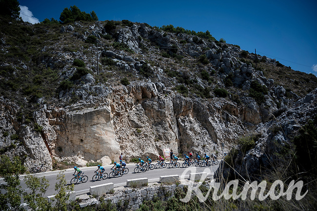 Team Astana, with red jersey (overall leader) Miguel Angel Lopez (COL/Astana), leading the peloton up the first catagorised climb of the day<br /> <br /> Stage 2: Benidorm to Calpe (199.6km)<br /> La Vuelta 2019<br /> <br /> ©kramon
