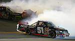 Kyle Busch No. 51 spins after contact with Mike Skinner No. 5 coming off turn 2 in the Chevy Silverado 250 truck race, Friday, February 15, 2008 Daytona International Speedway. (CHAD PILSTER)