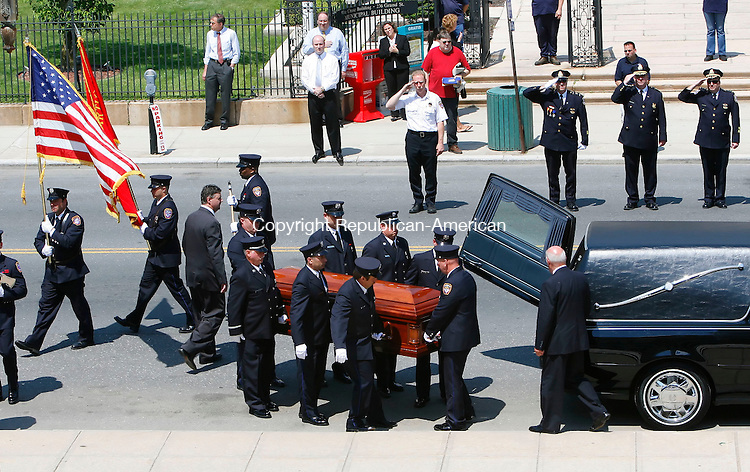 WATERBURY, CT 5/24/07- 052407BZ02- Pall Bearers bring the casket of Waterbury Fire Capt. John Keane into City Hall for the wake Thursday.  Keane, a Captain on Engine 8, died from injuries sustained when engine 12, a spare engine assigned to Station 8, he was riding in collided with Truck 1 at Rte. 73 and East Aurora Street last Saturday.<br /> Jamison C. Bazinet Republican-American