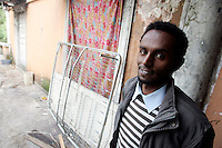 Rifugiati somali nell'ex ambasciata di Somalia a Roma, 29 dicembre 2010..Circa 200 rifugiati somali vivono in condizioni igieniche precarie nell'edificio che ospitava l'ambasciata e che e' stato abbandonato dopo la caduta del governo somalo negli anni Novanta..A Somalian refugee stands inside the former Somalian embassy in Rome, 29 december 2010. About 200 refugees live  in precarious hygienic conditions in the building, which is still the property of the Somali government but was abandoned after the collapse of the government in Mogadishu in the 1990s..© UPDATE IMAGES PRESS/UPDATE IMAGES PRESS/Riccardo De Luca