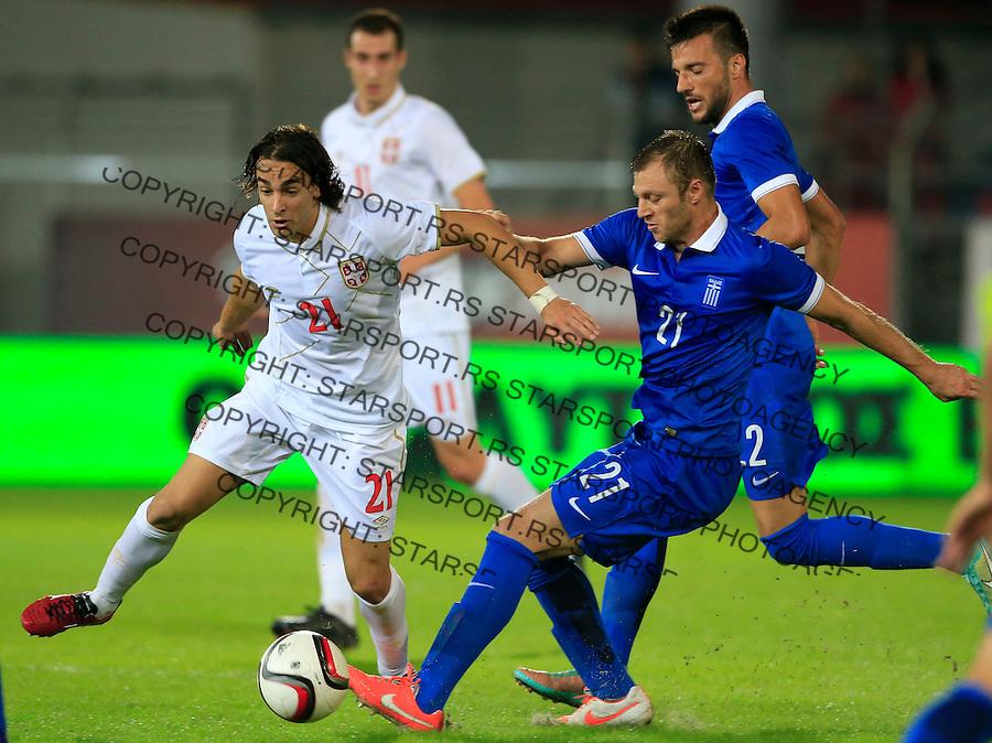 Fudbal<br /> Prijateljski mec-Friendly match<br /> Srbija v Grcka<br /> Lazar Markovic (L) and Avraam Papadopoulos<br /> Chania, 17.11.2014.<br /> foto: Srdjan Stevanovic/Starsportphoto &copy;