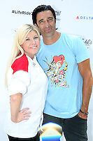 PHILADELPHIA, PA - AUGUST 12 :  Actor Gilles Marini pictured with Christine Hazel at the Kiehl's 7th Annual LifeRide For amfAR at Kiehl's in Philadelphia, Pa on August 12, 2016 photo credit Star Shooter/MediaPunch