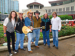 B.B. Borden, Pat Elwood, Stuart Swanlund, Rick Willis, Doug Gray, and Marcus James Henderson of The Marshall Tucker Band pose for photos during Day 1 of the 2013 CMA Music Festival in Nashville, Tennessee.