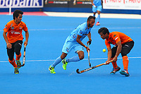 Najmi Jazlan of Malaysia competes with Sunil Sowmarpet of India during the Hockey World League Quarter-Final match between India and Malaysia at the Olympic Park, London, England on 22 June 2017. Photo by Steve McCarthy.