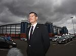 SPL Chief Neil Doncaster outside Hampden as storm clouds gather