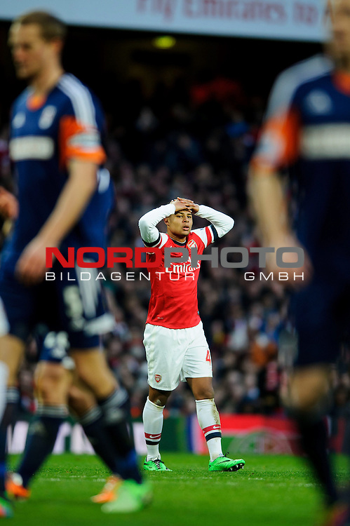 Arsenal Midfielder Serge Gnabry (GER) looks disappointed after a miss during the match -  - 18/01/14 - SPORT - FOOTBALL - Emirates Stadium - Arsenal v Fulham - Barclays Premier League.<br /> Foto nph / Meredith<br /> <br /> ***** OUT OF UK *****