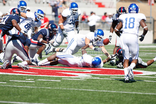 Ole Miss forces the second fumble of the first half from UK's Chris Matthews at Vaught-Hemingway Stadium on Saturday, Oct. 2, 2010. Photo by Scott Hannigan | Staff