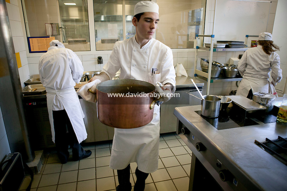 Students cook during a class at the Ecole Superieure de Cuisine Francaise Gregoire Ferrandi cooking school in Paris, France, 18 December 2007.