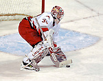 6 February 2007: Carolina Hurricanes goaltender Cam Ward makes a save against the Montreal Canadiens at the Bell Centre in Montreal, Canada.  The Hurricanes defeated the Canadiens 2-1.....Mandatory Photo Credit: Ed Wolfstein Photo *** Editorial Sales through Icon Sports Media *** www.iconsportsmedia.com