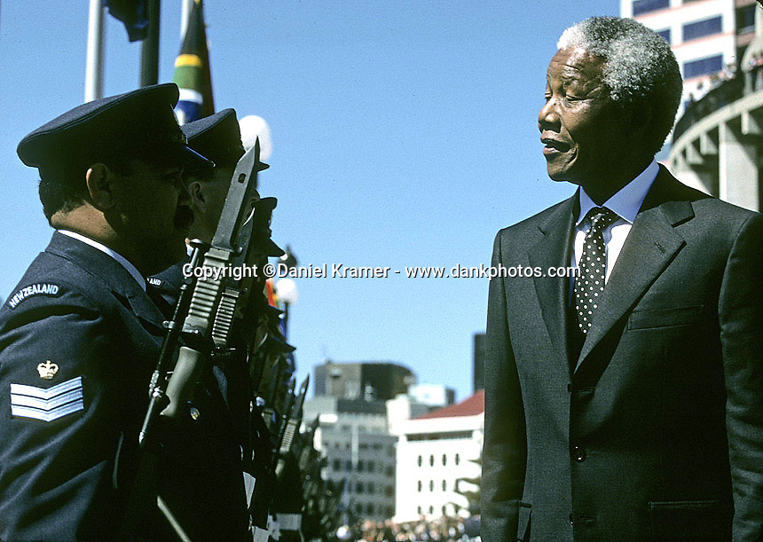 South African President Nelson Mandela reviews the New Zealand troops during the 1995 Commonwealth Heads of Government Meeting in Wellington, New Zealand. Mandela's attendance at the C.H.O.G.M. marked the first time South Africa had participated in the conference since leaving the Commonwealth in 1961.