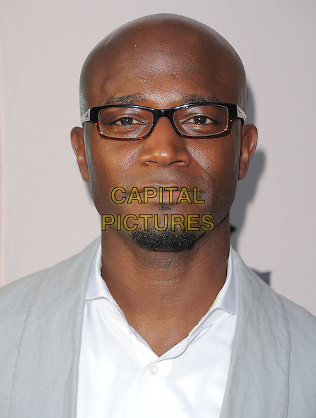 Taye Diggs.Welcome To ShondaLand: An Evening with Shonda Rhimes & Friends held at The Leonard H. Goldenson Theatre  in North Hollywood, California, USA..April 2nd, 2012.headshot portrait white grey gray glasses goatee facial hair .CAP/RKE/DVS.©DVS/RockinExposures/Capital Pictures.