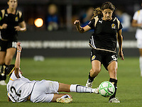 23 July 2009:  Lisa Sari of the Los Angeles Sol tries to tackle the ball away from Tina DiMartino of the FC Gold Pride during the game at Buck Shaw Stadium in Santa Clara, California.   FC Gold Pride tied Los Angeles Sol, 0-0.