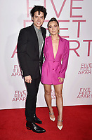 WESTWOOD, CA - MARCH 07: Cole Sprouse (L) and Haley Lu Richardson attend the Premiere Of Lionsgate's 'Five Feet Apart' at Fox Bruin Theatre on March 07, 2019 in Los Angeles, California.<br /> CAP/ROT/TM<br /> &copy;TM/ROT/Capital Pictures
