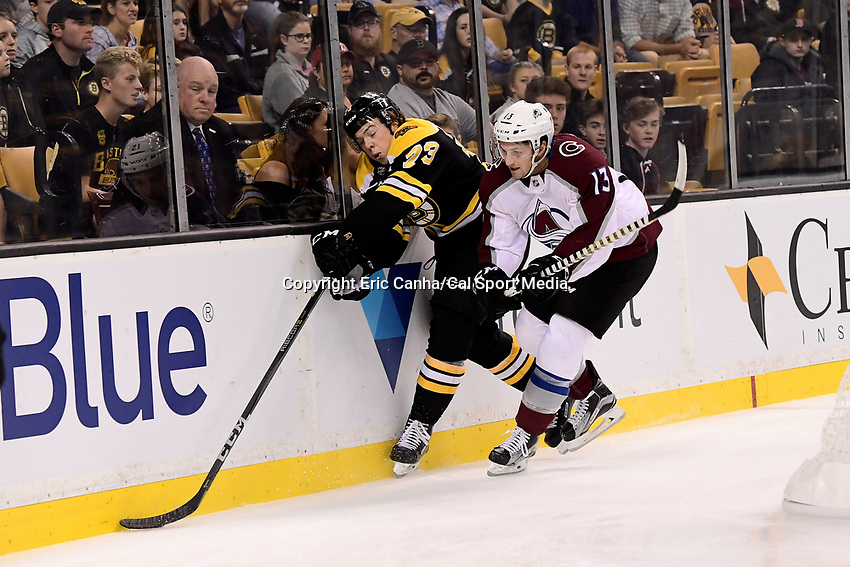October 9, 2017: Boston Bruins defenseman Charlie McAvoy (73) is checks by Colorado Avalanche center Alexander Kerfoot (13) during the NHL game between the Colorado Avalanche and the Boston Bruins held at TD Garden, in Boston, Mass. Colorado defeats Boston 4-0. Eric Canha/CSM