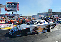 Oct. 27, 2012; Las Vegas, NV, USA: NHRA funny car driver Jack Beckman (near) races alongside Todd Lesenko during qualifying for the Big O Tires Nationals at The Strip in Las Vegas. Mandatory Credit: Mark J. Rebilas-