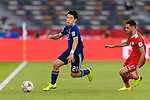 Doan Ritsu of Japan (L) is followed by Ali Al Busaidi of Oman during the AFC Asian Cup UAE 2019 Group F match between Oman (OMA) and Japan (JPN) at Zayed Sports City Stadium on 13 January 2019 in Abu Dhabi, United Arab Emirates. Photo by Marcio Rodrigo Machado / Power Sport Images