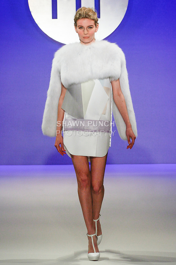 Model walks runway in an outfit by Kyu Sang Kim, during the FIT Future of Fashion 2014 Graduates' Collection fashion show, at the Fashion Institute of Technology on May 1, 2014.