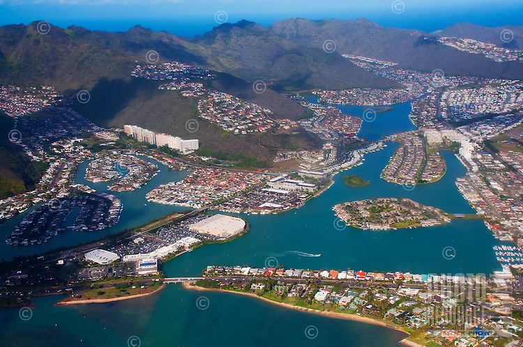 An aerial view of houses, businesses, mountains and the marina in Hawai'i Kai, East O'ahu.