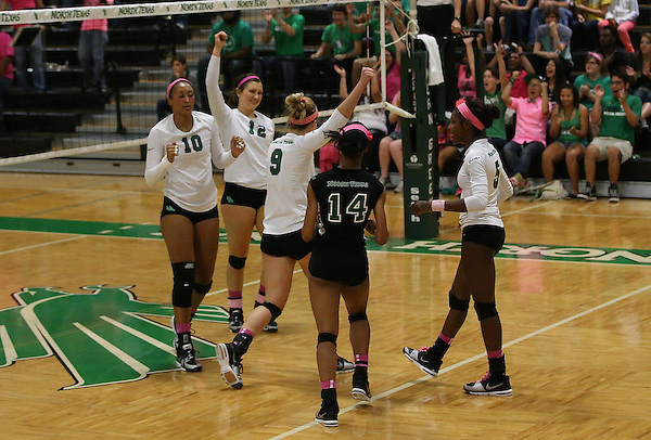 DENTON, TX -OCTOBER 11: Hanna Forst #9, Amy Henard #12, Eboni Godfrey #14, Karissa Flack #10, Carnae Dillard #5 - North Texas Mean Green Volleyball team vs at the Charlotte Forty Niners  Volleyball Athletic Complex in Denton on October 11, 2013 in Denton Texas. (Photo by Rick Yeatts)