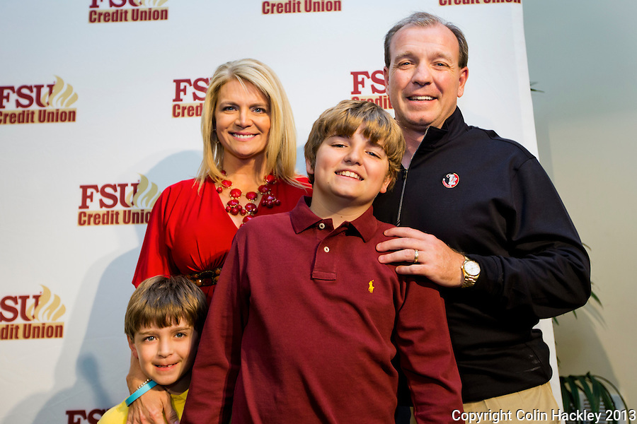 TALLAHASSEE, FLA. 2/6/13-FSUSIGNDAY020613 CH-Head Coach Jimbo Fisher, right, is joined by his sons Ethan, left, and Trey and wife Candi, during Florida State University's national signing day War Party, Feb. 6, 2013 in Tallahassee..COLIN HACKLEY PHOTO