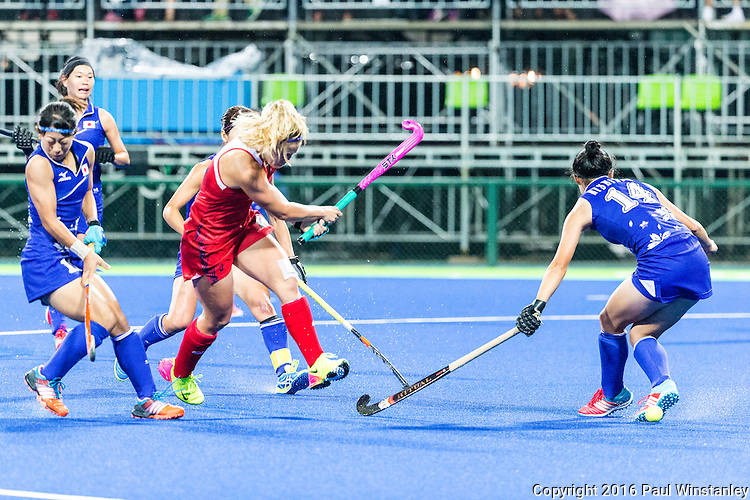Katie Bam #16 of United States takes a shot while Emi Nishikori #14 of Japan tries to block during USA vs Japan in a Pool B game at the Rio 2016 Olympics at the Olympic Hockey Centre in Rio de Janeiro, Brazil.