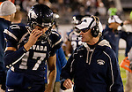 November 12, 2011:Nevada coach Chris Ault talks with quarterback Cody Fajardo on the sidelines during a WAC league game vs Hawaii played at Mackay Stadium in Reno, Nevada.