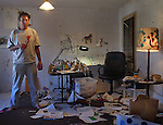 Artist Raymond Pettibon in his home studio in Long Beach. He works with ink on paper.