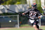 Corona Del Mar, CA 04/06/10 - Hunter Doliber (Danville/Monte Vista #22) and unknown Corona Del Mar player in action during the Corona Del Mar-Danville/Monte Vista lacrosse game.