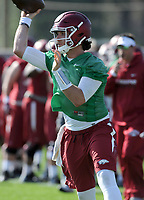 NWA Democrat-Gazette/ANDY SHUPE<br /> Arkansas quarterback Austin Allen rolls out to make a pass Tuesday, March 28, 2017, during spring practice at the UA practice facility in Fayetteville.