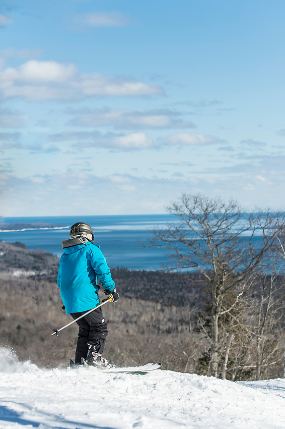 Skiers on the open runs of Mount Bohemia ski area in Michigan.