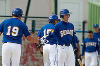 22 May 2009: Matthieu Brelle Andrade of Senart congratulates Rhett Teller  during the 2009 challenge de France, a tournament with the best French baseball teams - all eight elite league clubs - to determine a spot in the European Cup next year, at Montpellier, France. Senart wins 7-1 over Montpellier.