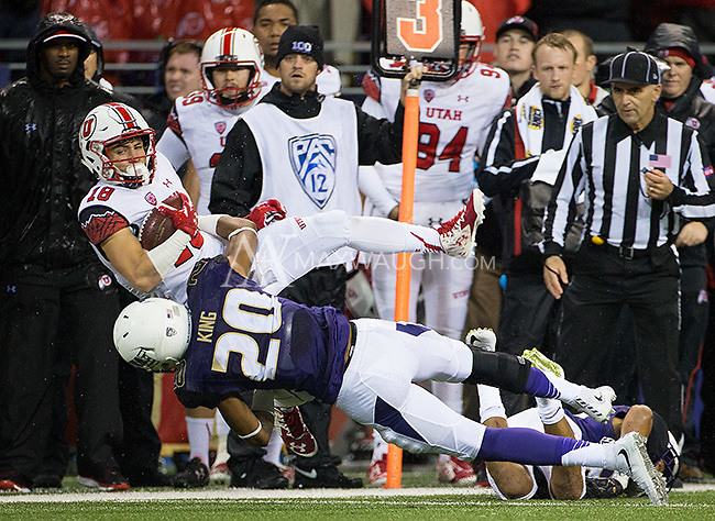 Kevin King (20) takes down Ute receiver Britain Covey.