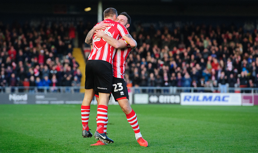 Lincoln City's Harry Anderson, left, celebrates scoring his side's second goal with team-mate Neal Eardley<br /> <br /> Photographer Chris Vaughan/CameraSport<br /> <br /> The EFL Sky Bet League Two - Lincoln City v Newport County - Saturday 22nd December 201 - Sincil Bank - Lincoln<br /> <br /> World Copyright © 2018 CameraSport. All rights reserved. 43 Linden Ave. Countesthorpe. Leicester. England. LE8 5PG - Tel: +44 (0) 116 277 4147 - admin@camerasport.com - www.camerasport.com