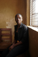 Miranda sits beside a window in the 'City of Rest', a rudimentary counselling and mini rehabilitation centre for recovering drug addicts, alcoholics and traumatised or delinquent youths.  She was sent by her Father to the centre which is run by a pastor who attributes the centre's success to the extensive rest, food and prayer. © Fredrik Naumann Freetown, Sierra Leone.