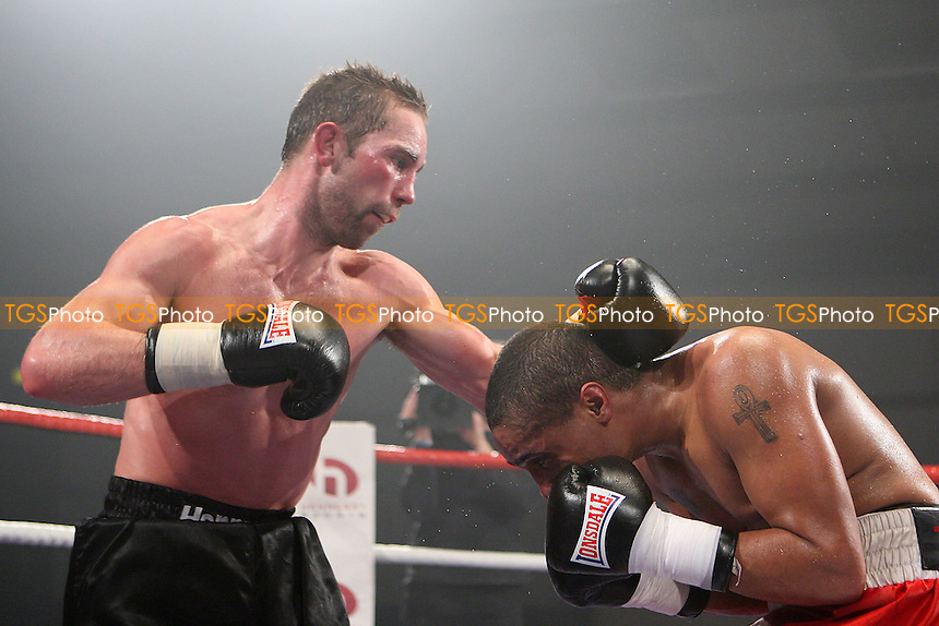 Matthew Thirlwall (Bermondsey, black shorts) defeats James Tucker (Doncaster, red shorts) in a Middleweight boxing contest at Norfolk Showground, Norwich, promoted by Hennessy Sports - 28/02/09 - MANDATORY CREDIT: Chris Royle/TGSPHOTO - Self billing applies where appropriate - 0845 094 6026 - contact@tgsphoto.co.uk - NO UNPAID USE.