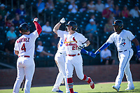 Surprise Saguaros second baseman Andy Young (29), of the St. Louis Cardinals organization, is congratulated by Jeremy Martinez (4) after scoring a run during an Arizona Fall League game against the Salt River Rafters on October 9, 2018 at Surprise Stadium in Surprise, Arizona. Salt River defeated Surprise 10-8. (Zachary Lucy/Four Seam Images)