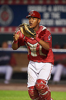 Harrisburg Senators catcher Pedro Severino (4) waits for a throw in a rundown during a game against the New Hampshire Fisher Cats on July 21, 2015 at Metro Bank Park in Harrisburg, Pennsylvania.  New Hampshire defeated Harrisburg 7-1.  (Mike Janes/Four Seam Images)