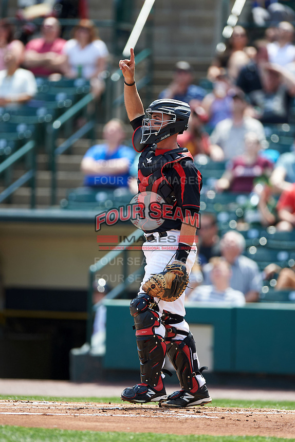 Rochester Red Wings catcher Eric Fryer (22) points to a pop up during a game against the Norfolk Tides on May 3, 2015 at Frontier Field in Rochester, New York.  Rochester defeated Norfolk 7-3.  (Mike Janes/Four Seam Images)