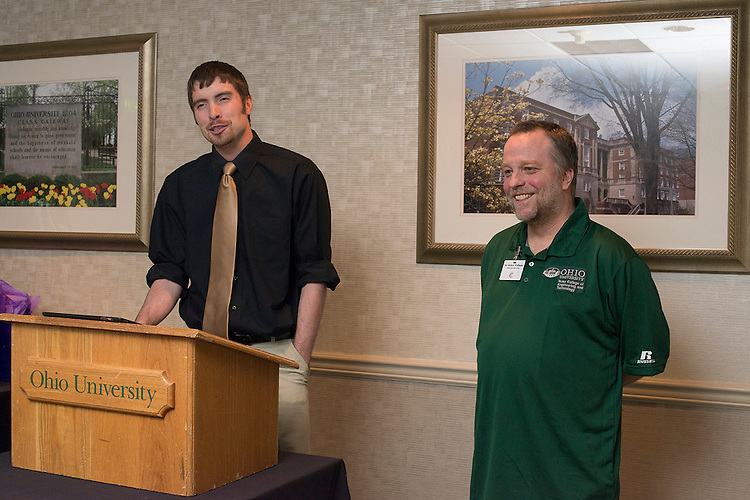 Senior Cutler Scholar Deon Baum presents a gift to his mentor Dr. Robert Williams, a Professor and the Assistant Chair in the Department of Mechanical Engineering at the Russ College of Engineering & Technology. © Ohio University / Photo by Olivia Wallace