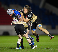 Bryn Evans of Sale Sharks is double-tackled by Benjamin Lucas and Wiaan Liebenberg of Montpellier. European Rugby Challenge Cup quarter final, between Sale Sharks and Montpellier on April 8, 2016 at the AJ Bell Stadium in Manchester, England. Photo by: Patrick Khachfe / JMP