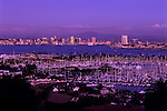 San Diego skyline at twilight with city lights and bay with marinas and boats, San Diego, California USA