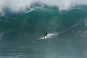 Keone Downing (HAW) during the Quiksilver Eddie Aikau at Waimea Bay on the Northshore of Oahu in Hawaii