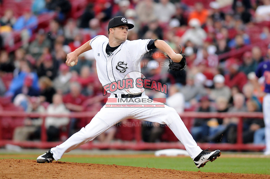 Relief pitcher Evan Beal (14) of the South Carolina Gamecocks pitches in a game against the Clemson Tigers on March 3, 2012, at Carolina Stadium in Columbia, South Carolina. South Carolina won, 9-6 and Beal got the win. (Tom Priddy/Four Seam Images)