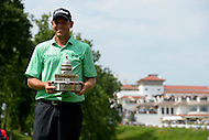 June 30, 2013  (Bethesda, Maryland)  Bill Haas holds the AT&T National Championship trophy after winning the tournament at Congressional Country Club in Bethesda, MD. (Photo by Don Baxter/Media Images International)