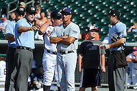 Southern League Umpire Spencer Flynn explains the ground rules to Pensacola manager Jim Riggleman #8 while Smokies manager Buddy Bailey #26 talk with umpires Thomas Newsom and Jonathan Bailey before game one of a double header between the Pensacola Blue Wahoos and the  Tennessee Smokies at Smokies Park on July 30, 2012 in Kodak, Tennessee. The Smokies defeated the Blue Wahoos 6-3 in game one and 3-2 in game two. (Tony Farlow/Four Seam Images).