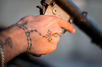 August 2017. Raqqa, Syria.<br /> A tattoo of a cross can be seen on the hand of a soldier belonging to the MFS on the western front lines of Raqqa, Syria.<br /> The MFS (Syriac Military Council) are a group of Assyrian Christians who fight alongside the Syrian Democratic Forces in the fight to topple ISIS.<br /> Photographer: Rick Findler