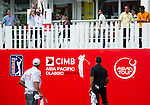 Stewart Cink throws a ball to the crowds on the eighteenth green during Round 2 of the CIMB Asia Pacific Classic 2011.  Photo © Raf Sanchez / PSI for Carbon Worldwide