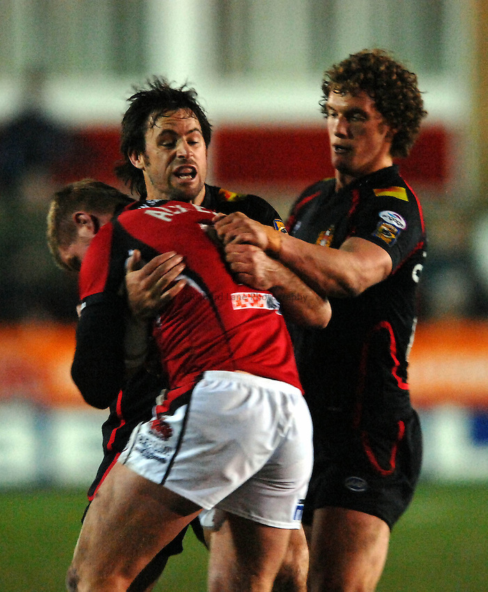 Photo: Richard Lane Photography..Salford Reds v Wigan Warriors. Engage Super League 2007. 16/03/2007. Salford's Malcolm Alker (C) is stopped by Phil Bailey and Sean O'Loughlin (R)