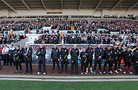 Pictured: The Aston Villa bench observe a minute's silence  before kick off in memory of Wales football manager Gary Speed who has died. Saturday 27 November 2011<br /> Re: Premier League football Swansea City FC v Aston Villa at the Liberty Stadium, south Wales.